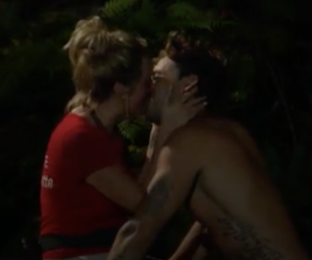 The couple shared a cheeky kiss in the jungle.