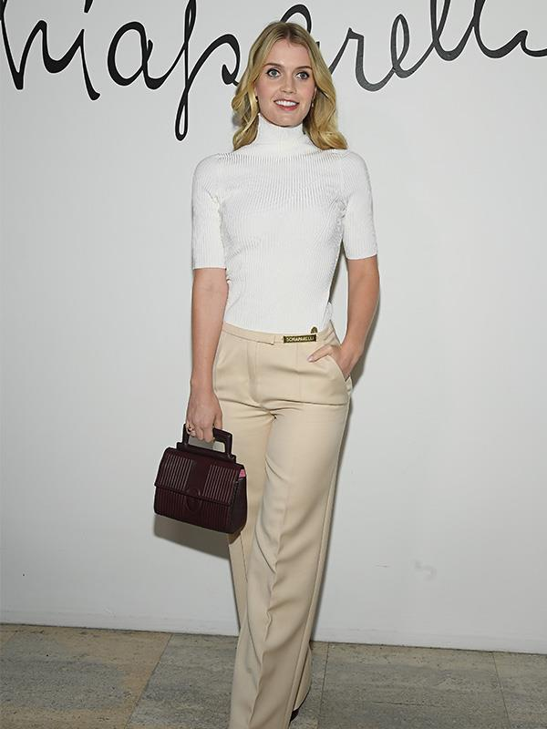 Kitty looked chic and professional at the event.