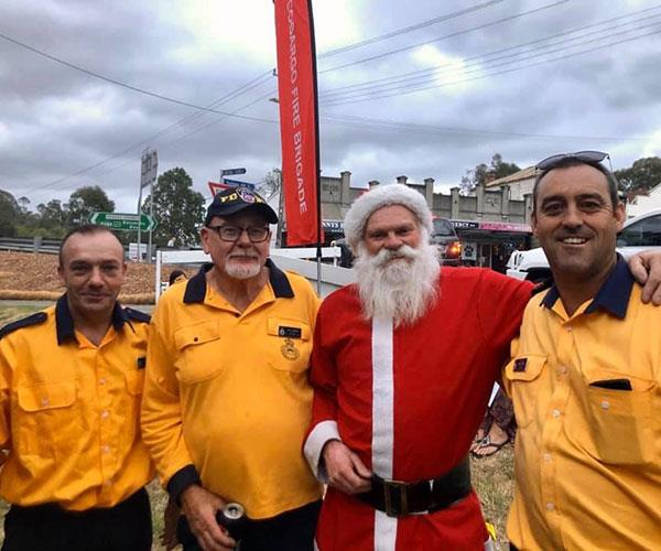 Dave dressed as santa with the local firefighters.