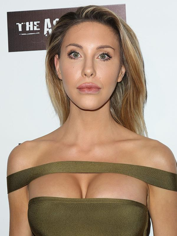 Chloe showed off her ample chest in this revealing dress in 2016.