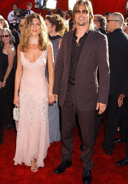 For the 2002 Emmy's, Jennifer's pink embellished gown was pure heaven. Unsure what's up with Brad's hair at this stage, but we'll let it slide.
