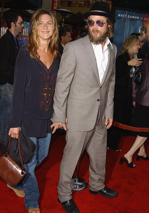 It wouldn't be an early 2000s fashion wrap without at least one tunic appearing over a pair of straight leg jeans now would it? Meanwhile, Brad's facial hair grows even longer...