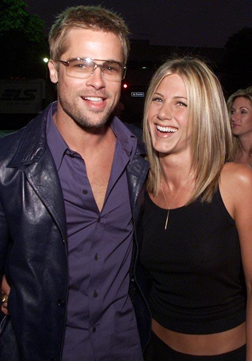 Fast-forward to 2001 and the pair were all smiles at the *Rock Star* premiere - Jen at it again with the bare hipbones. What a moment.