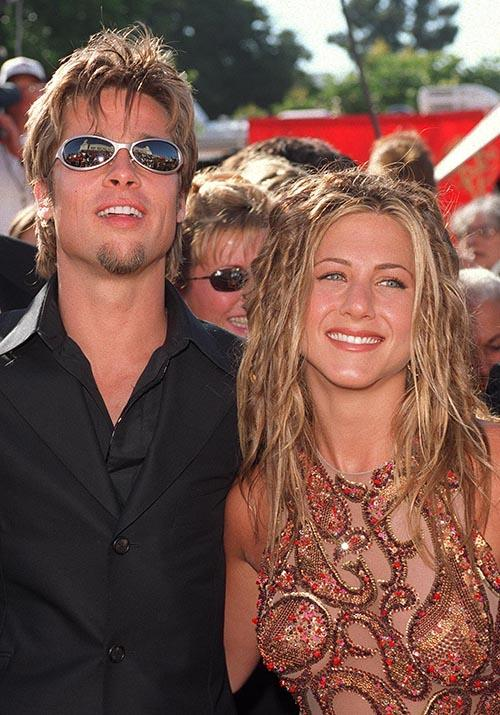 Behold the 1999 Emmy Awards - Jen embraced dreadlock-chic (wild), while Brad was zero per cent bothered by so-called red-carpet attire. Those sunnies, bro.