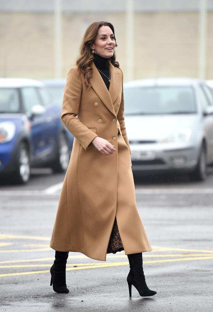 Kate looked gorgeous in a long camel coat - but it was what she wore underneath that really caught our attention.