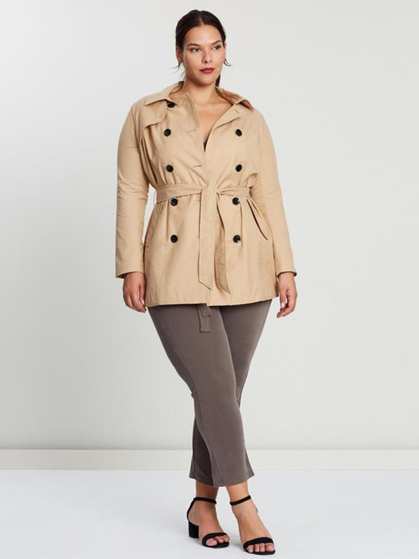 "If you live in a warmer climate, say in Queensland, a bit woolly coat isn't really necessary. But this lighter option from plus-size brand Only Carmakoma is made of a lightweight cotton, perfect for when you need just a thin layer on top. $78 from [The Iconic](https://www.theiconic.com.au/ania-long-trenchcoat-873525.html|target=""_blank""