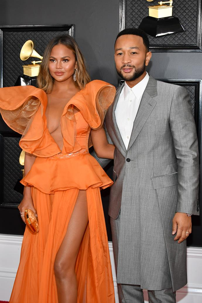 The legends themselves. Chrissy Teigen and John Legend are red carpet goals. Obsessed with Chrissy's zesty orange dress.