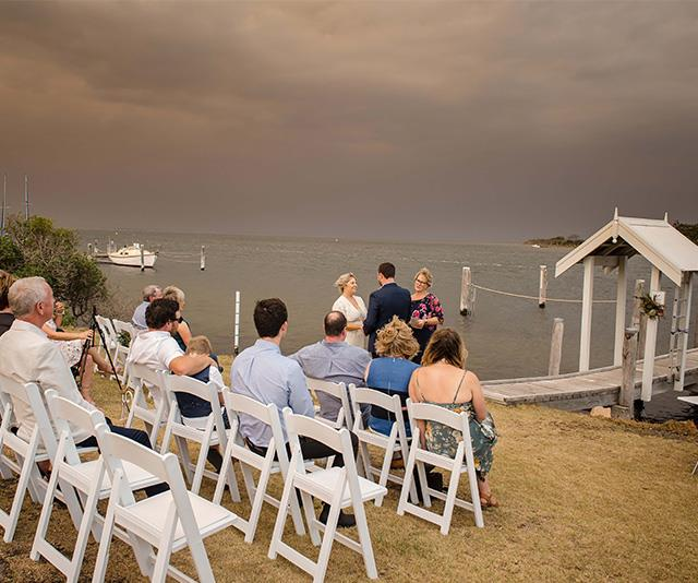 "Heavy smoke in the background didn't deter this couple from saying ""I Do""."
