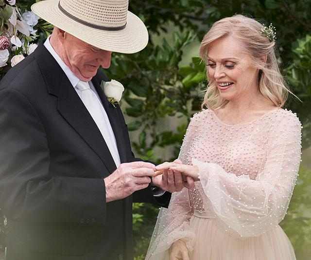 Alf puts the ring on Martha's finger to seal the deal.