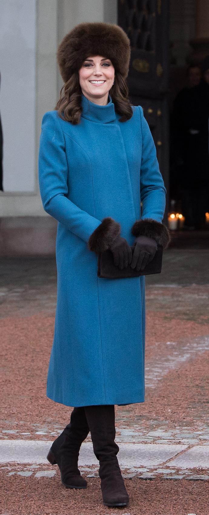 Kate wrapped up warm in this Catherine Walker coat during a trip to Oslo in 2018 - and if you look closely you'll *just* catch a glimpse of her burgeoning baby bump. She was pregnant with Prince Louis at the time.