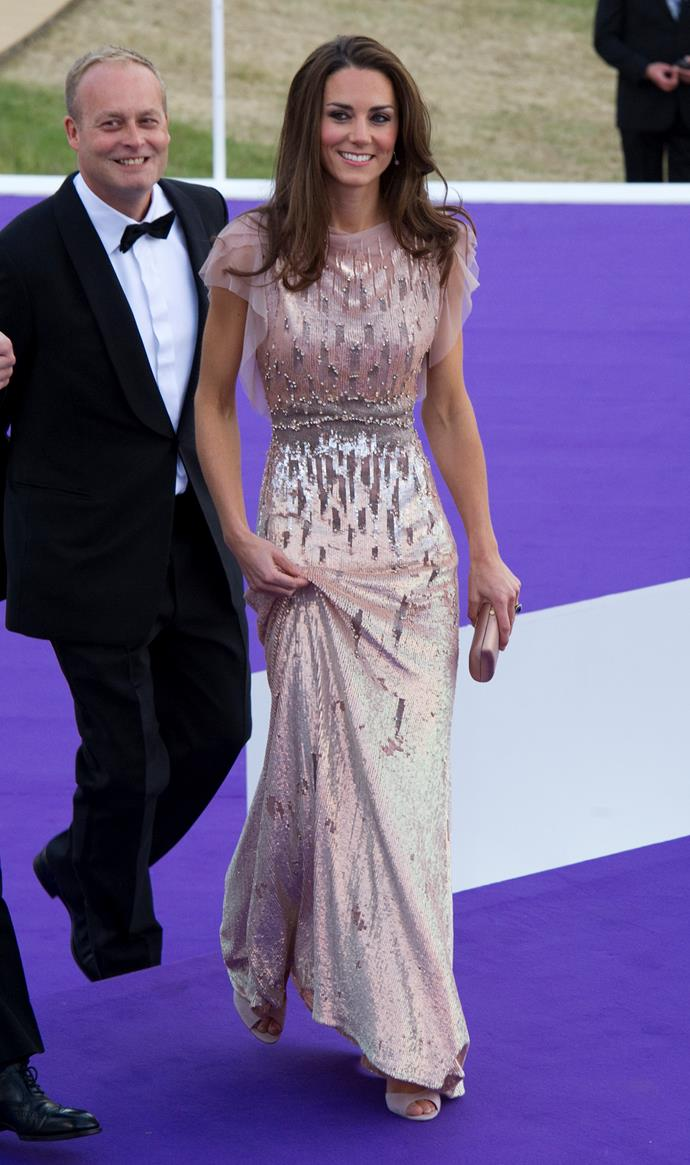 Let's begin with *the* GOAT - the gown of our real-life dreams. Kate kicked off royal life with a bang shortly after her wedding to Prince William in 2011 when she wore this heavenly Jenny Packham gown.
