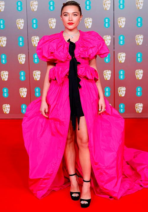 *Little Women* star Florence Pugh had zero trouble in standing out from the crowd in a bright fuchsia and black Dries Van Noten x Christian Lacroix frock.
