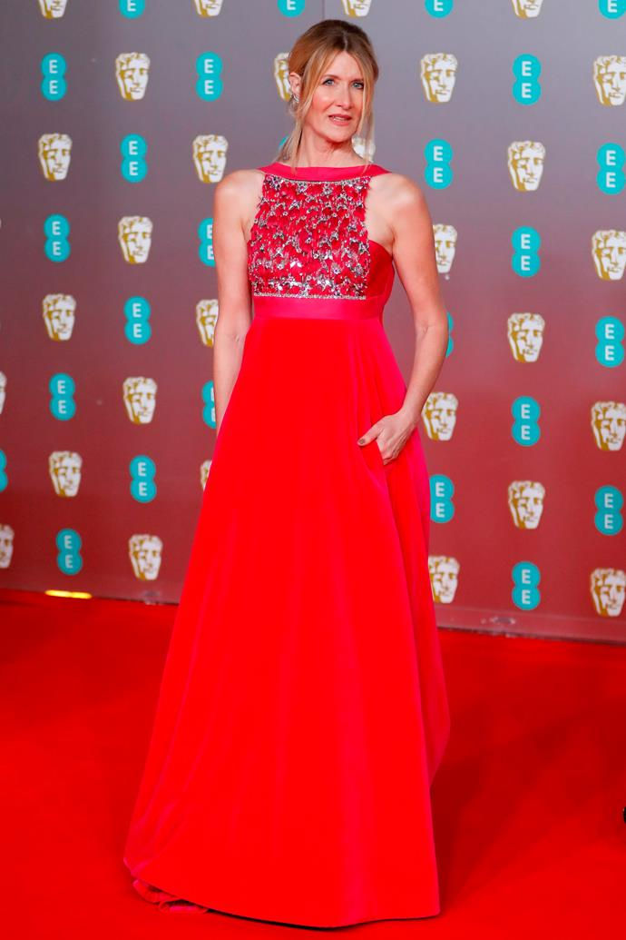US actress Laura Dern stunned in Valentino in signature red for the glitzy evening.