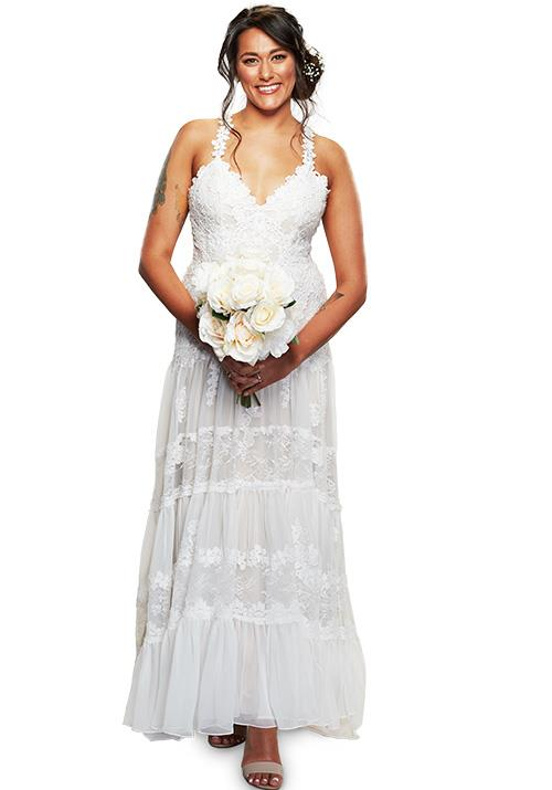 Connie went for a feminine design, featuring a floral lace bodice and beautiful tiered skirt.
