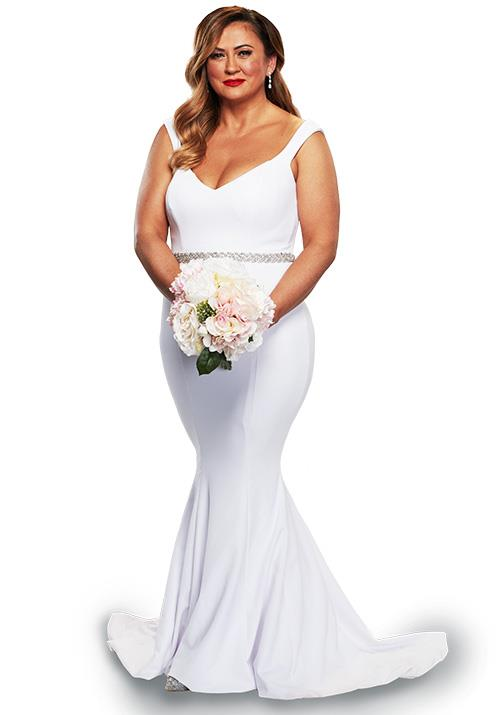"Mishel's thin-strapped [boat-neck design](https://www.nowtolove.com.au/lifestyle/weddings/jessica-mulroney-meghan-markle-wedding-dress-57169|target=""_blank"") was another royal-esque ode - Meghan Markle eat your heart out!"