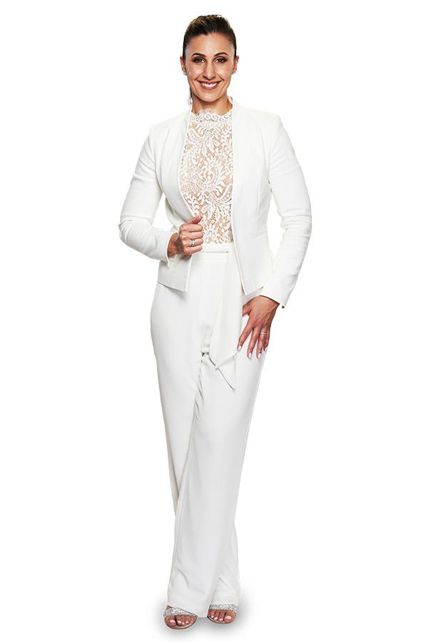 Amanda chose to wear a chic white jumpsuit on her wedding day.