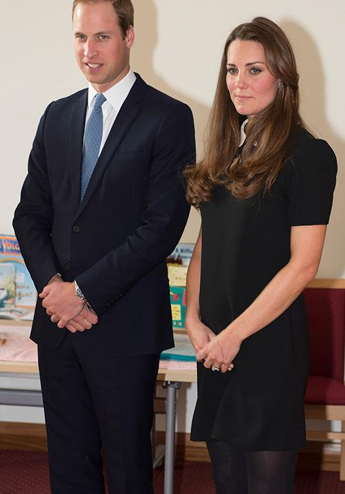 In March 2013, pregnant Kate's baby bump was *just* beginning to show in this AUD $96 Topshop dress as she and Wills visited a Child Bereavement centre.