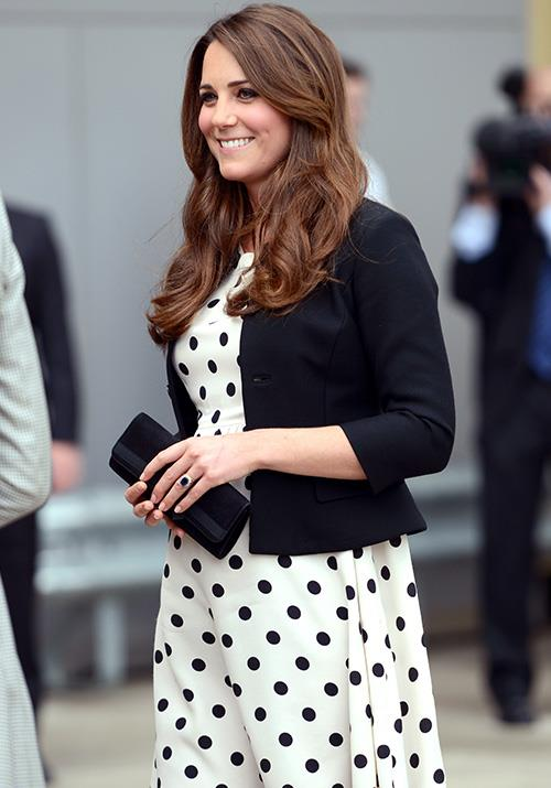 Later that year, a now-heavily-pregnant Kate wore this spotted AUD $112 Topshop dress to a tour of the Warner Bros. studios.
