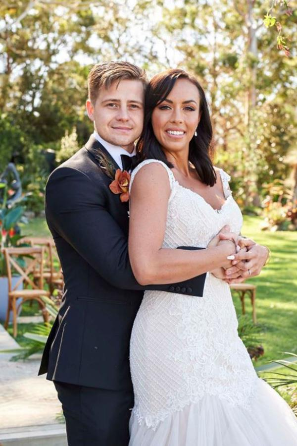 Mikey and Natasha pictured embracing on their wedding day.