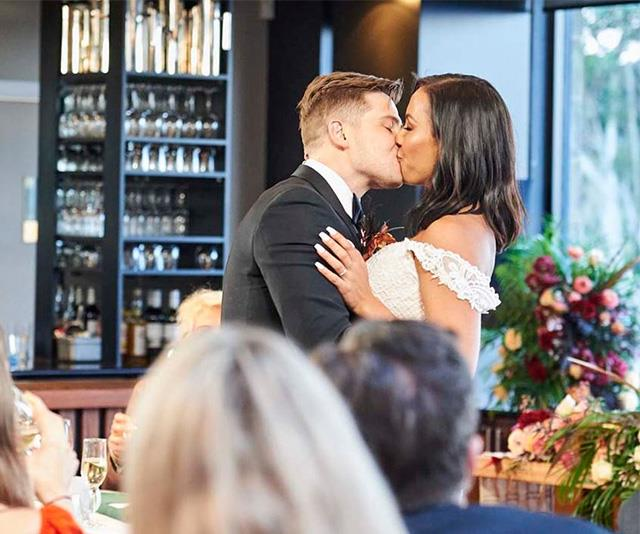 The couple shared a sweet kiss during their wedding reception.