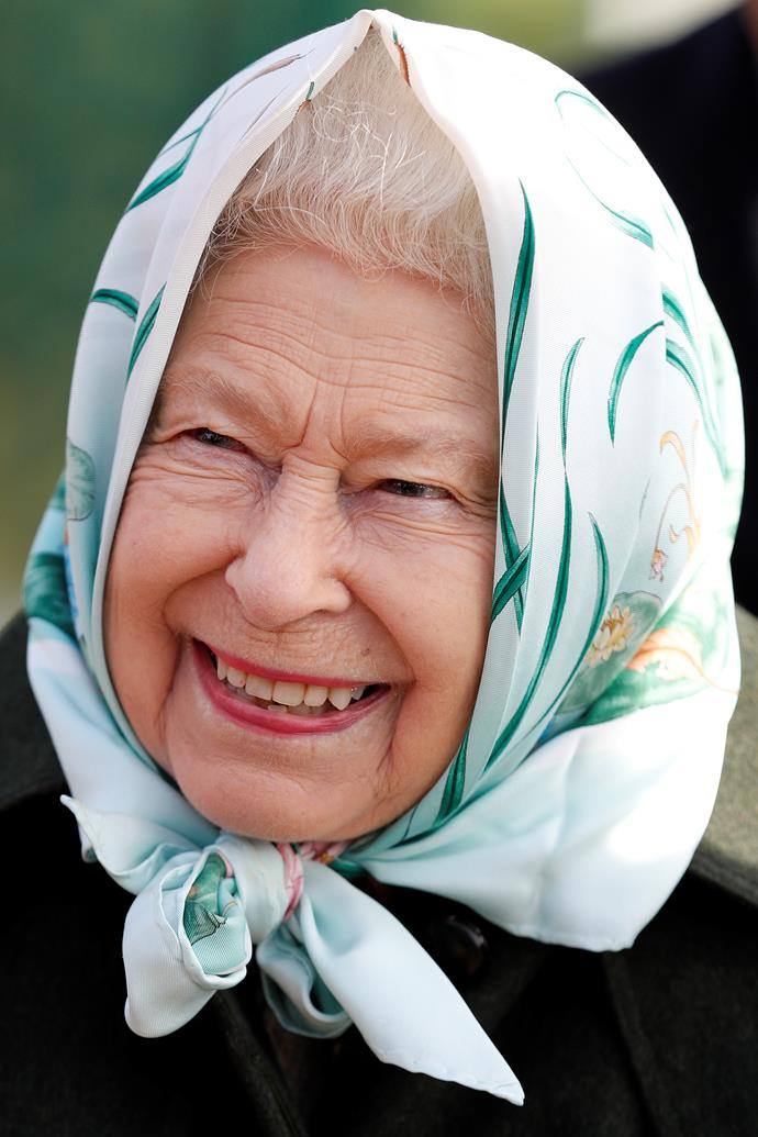 The reigning Monarch looked radiant in a bright headscarf.