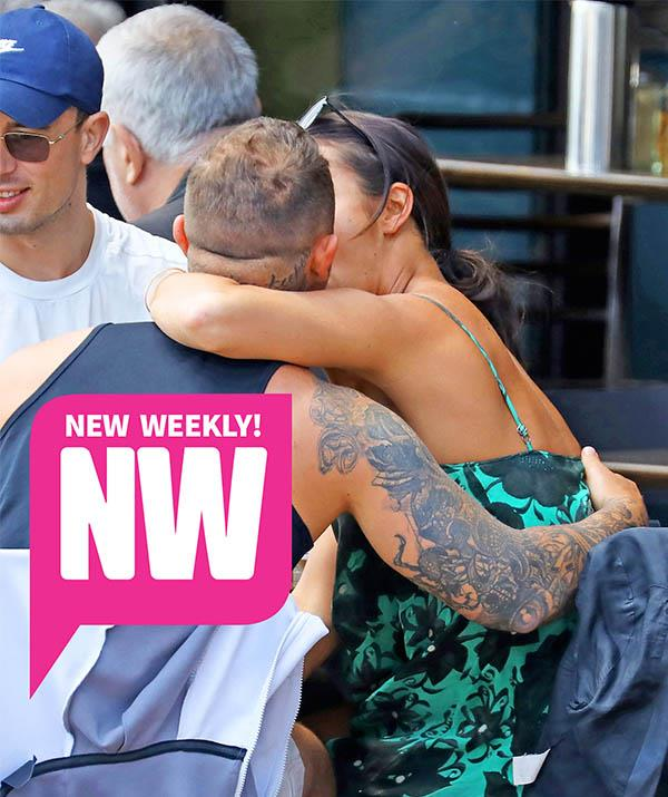 Nat was photographed getting cosy with another man - whose identity remains a mystery!