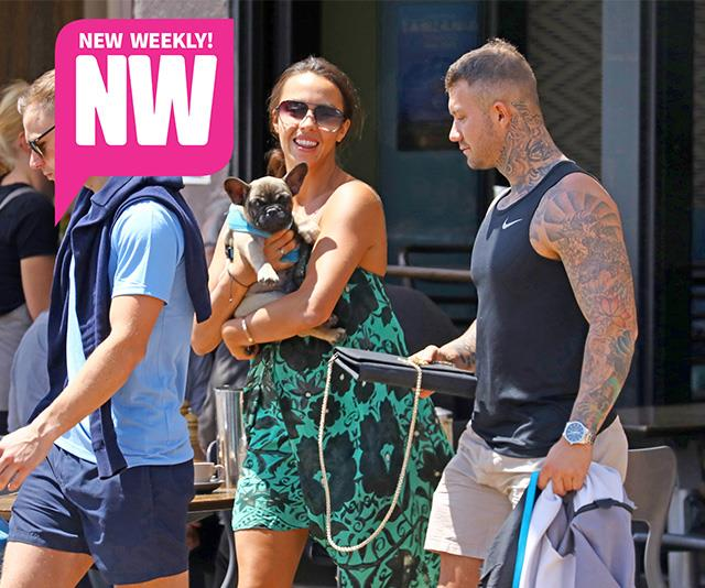 Natasha was all smiles as she was pictured with the tattooed hunk.