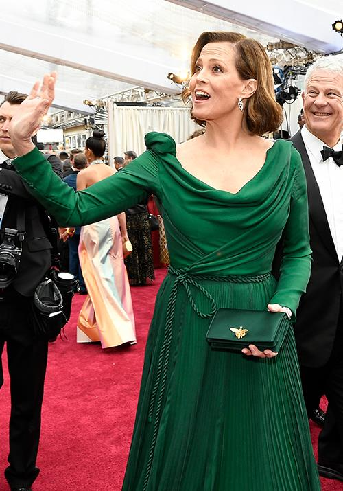70-year-old actress Sigourney Weaver is a vision in green as she waves to onlookers.
