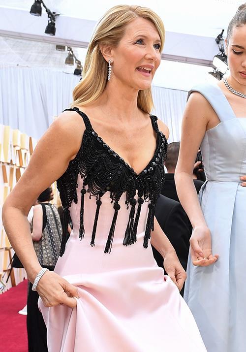 *Little Women* star Laura Dern looks heavenly in a pink gown featuring a unique black tassel neckline. It kinda works!