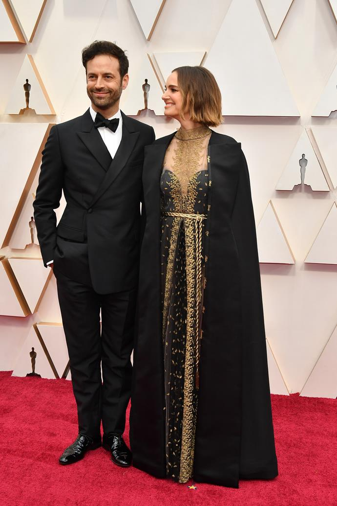Natalie Portman looks regal in a black and gold caped ensemble, and her husband Benjamin Millepied probably feels like the luckiest bloke in the house.