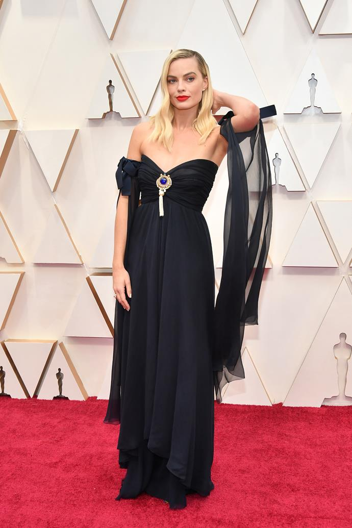 Aussie golden girl Margot Robbie is classic and chic in a navy blue Chanel design.