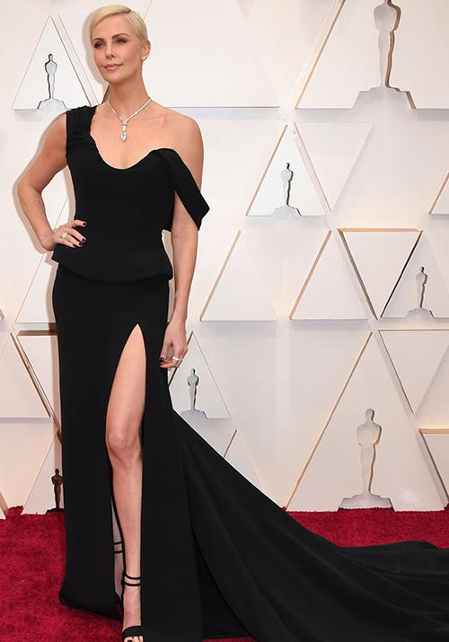 Charlize Theron opts for glamour with an edge in this off-shoulder black dress.