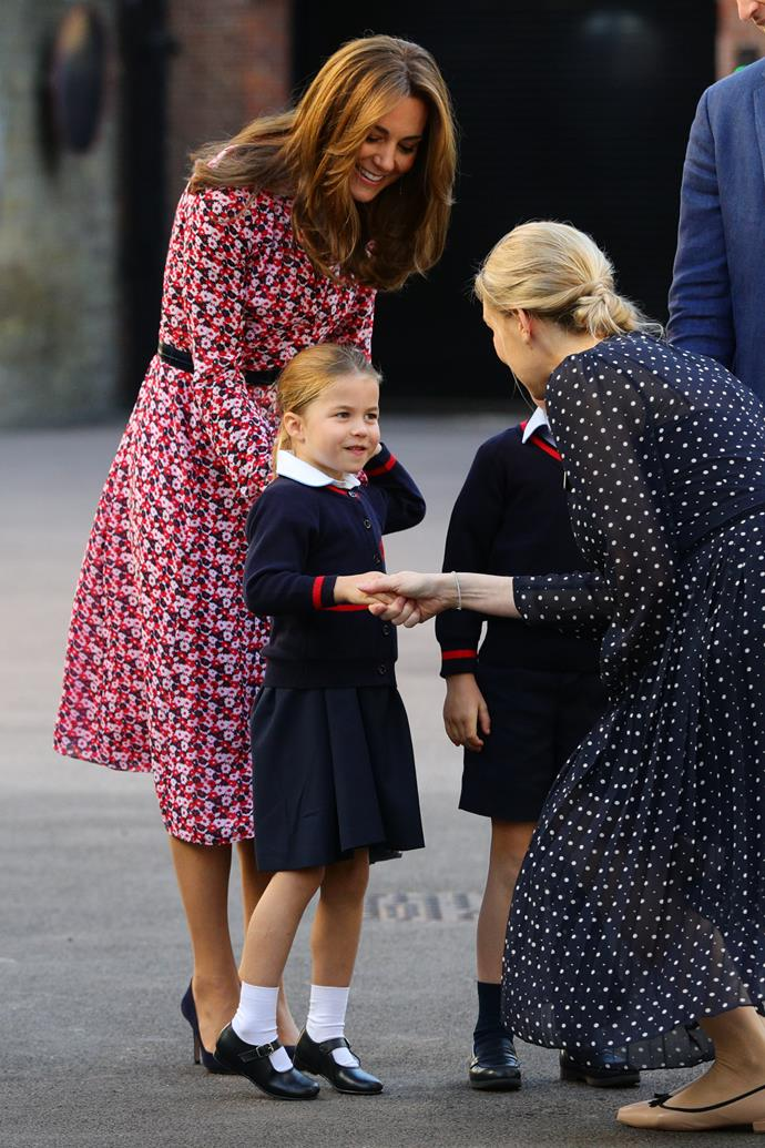 On her first day of school, Princess Charlotte confidently shook hands with the headmistress and like her mum, no doubt charmed her teacher.