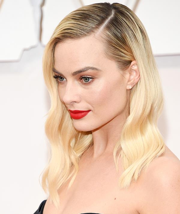 A golden girl always, Margot Robbie opted for a bold red lip and mermaid waves. Glamour at its finest!