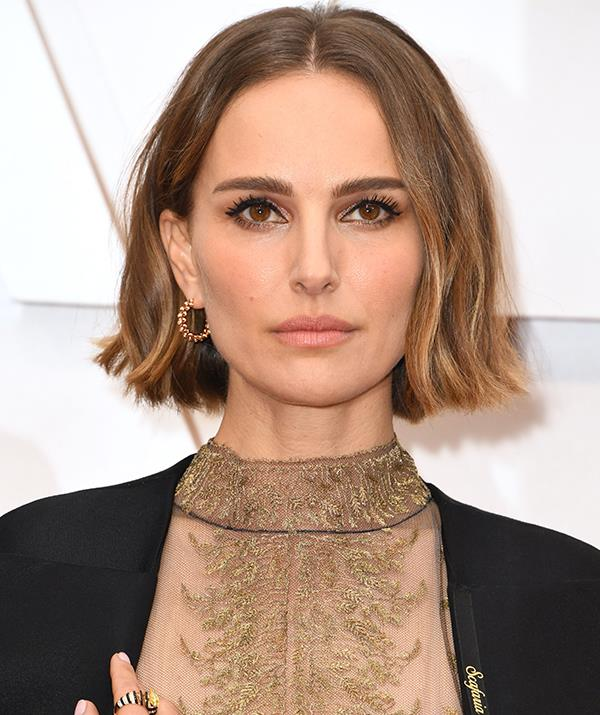 Natalie Portman let her eyes do the talking with a fierce lined look - the perfect addition to her knockout ensemble, which featured an incredible embroided cape showcasing names of female directors who missed out on an Oscars nod.