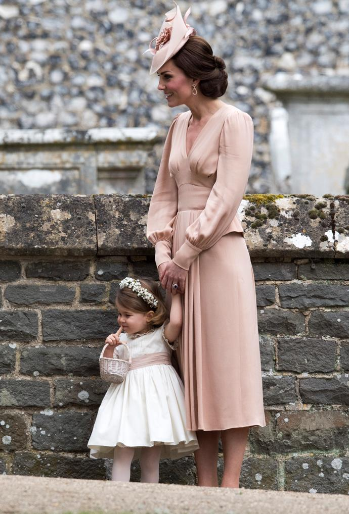 At Aunty Pippa's wedding, flowergirl Charlotte and unofficial maid of honour Catherine were as elegant as ever in peach.