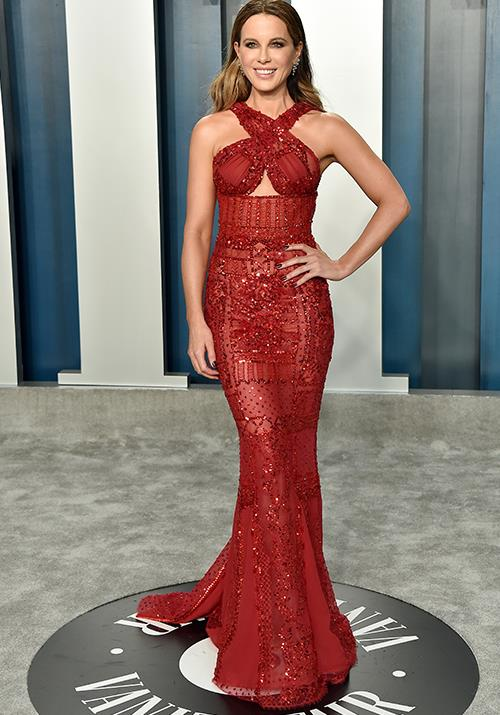 Kate Beckinsale was glowing in this enviable red sparkly gown.