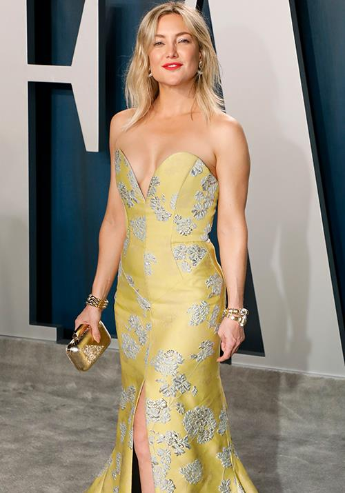"""Hollywood sweetheart Kate Hudson looked gorgeous as ever in this buttercup yellow design - it's not unlike the iconic yellow-gold dress she wore in her iconic 2003 role in *[How to Lose a Guy in 10 Days](https://www.imdb.com/title/tt0251127/