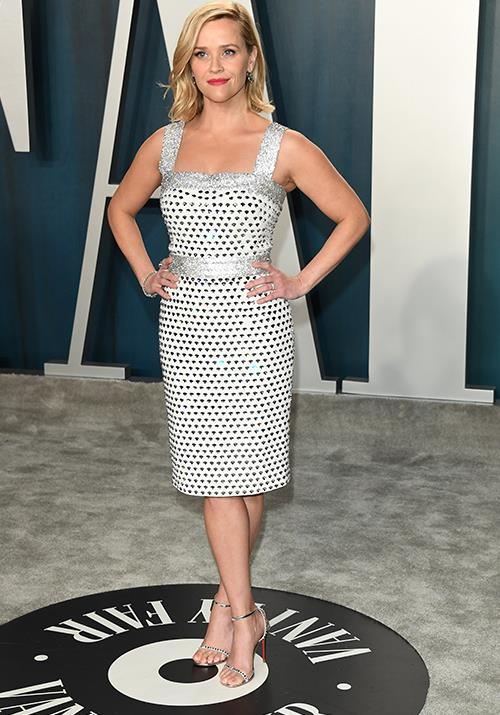 Reese Witherspoon opted for a chic silver and white design that literally sparkled.