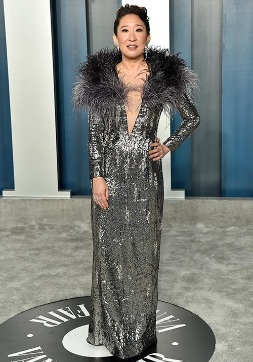 Sandra Oh brought a burst of feathers and sequins to the glitzy affair.