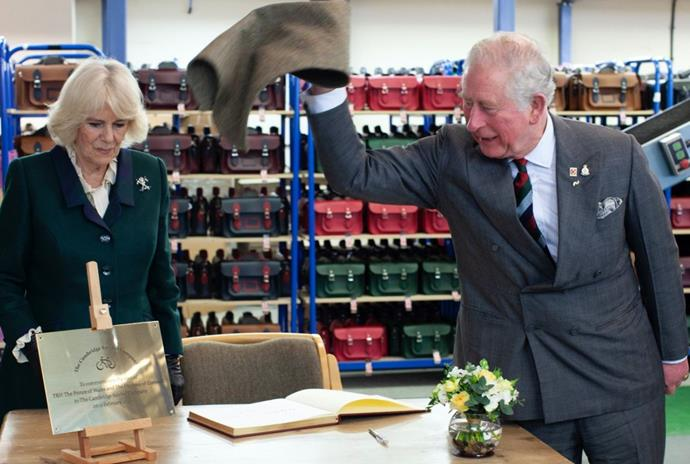 The Prince was joined by wife Duchess Camilla as he visited a bag-making factory in Leicestershire.
