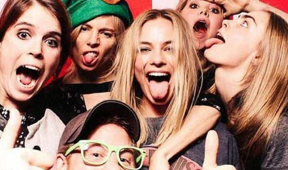 Margot (centre) was pictured at a Christmas party alongside Prince Harry (bottom) and Princess Eugenie (far left) - as well as Sienna Miller and Cara Delevigne.