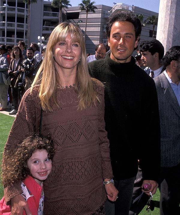 ONJ and a very adorable Chloe (look at those curls!) pictured with her ex-husband Matt Lattanzi in 1991, at the *Teenage Mutant Ninja Turtles* movie premiere in California. Olivia and Matt met in  on the set of *Xanadu* and were married in 1984, but split in 1995.  <br><br> She has since repartnered and married her current husband John Easterling, founder and president of the Amazon Herb Company, in 2008.