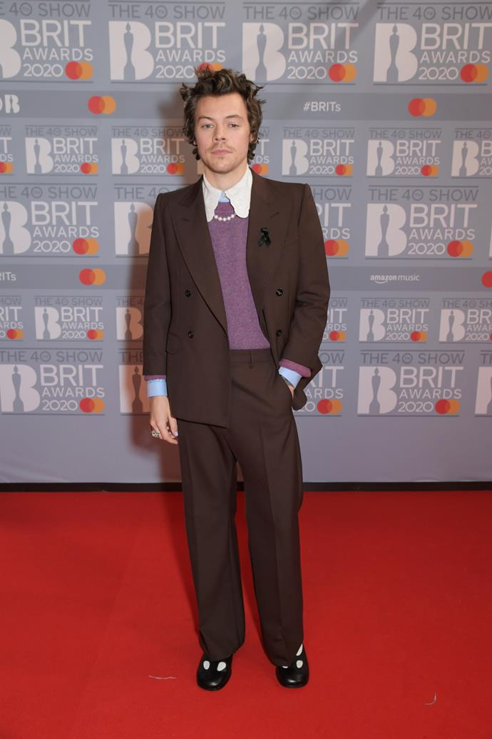 Meanwhile his former bandmate Harry Styles opted for a purple and brown ensemble.