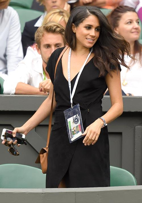 Later that year, Meghan was spotted attending Wimbledon wearing a plain black dress. Of course, she made the simple look hella significant with that ridiculously perfect blow dry.