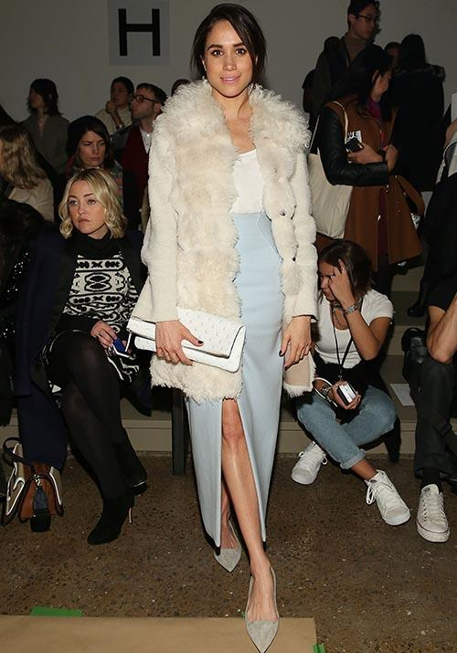 Attending a Fashion Week event in 2015, Meghan's somewhat unusual outfit consisting white faux-fur, a blue midi skirt and a very loosely thrown back hairstyle actually works. Honestly, only Meg could pull this one off.