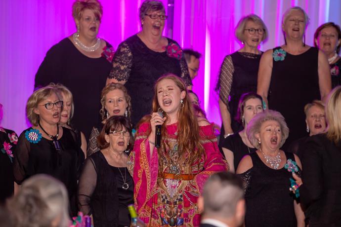 Bella McGavin singing at Pink Meets Teal.
