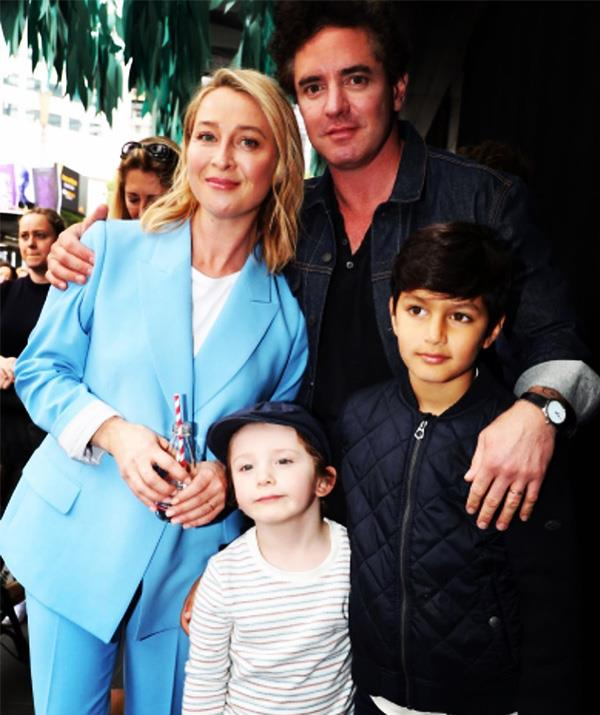 Asher, left, pictured with her son Valentino, husband Vincent and his son Luca, from a previous relationship.
