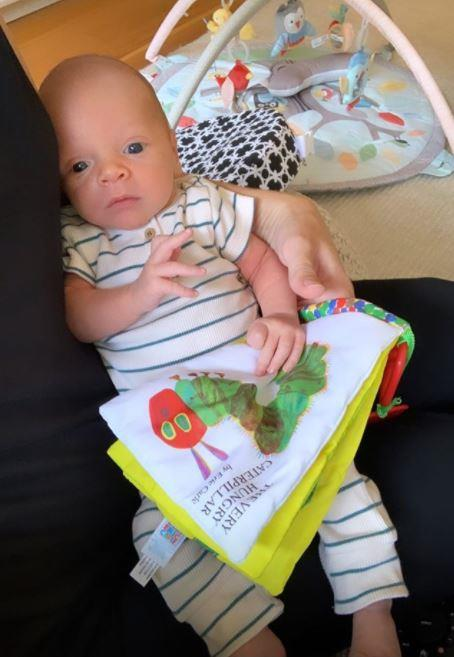 With two journalists for parents, Oscar's going to have plenty of books on hand when he's older.