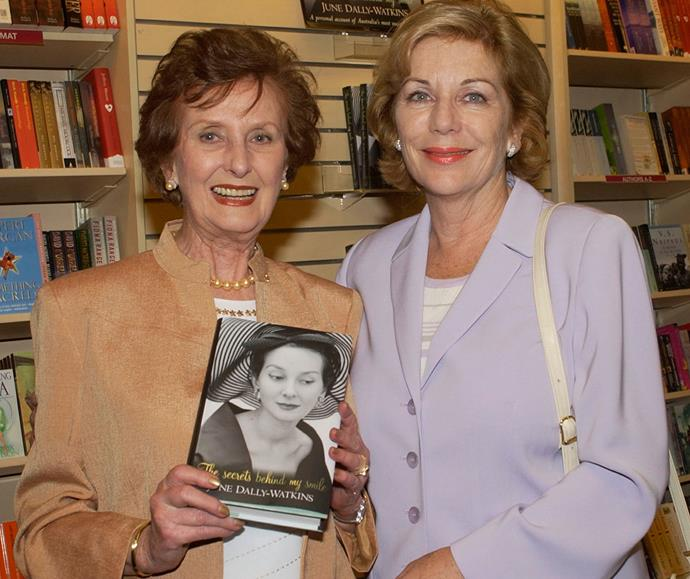 June launching her memoir *The secrets behind my smile* with former Editor-in-Chief of *The Weekly* Ita Buttrose in 2002.